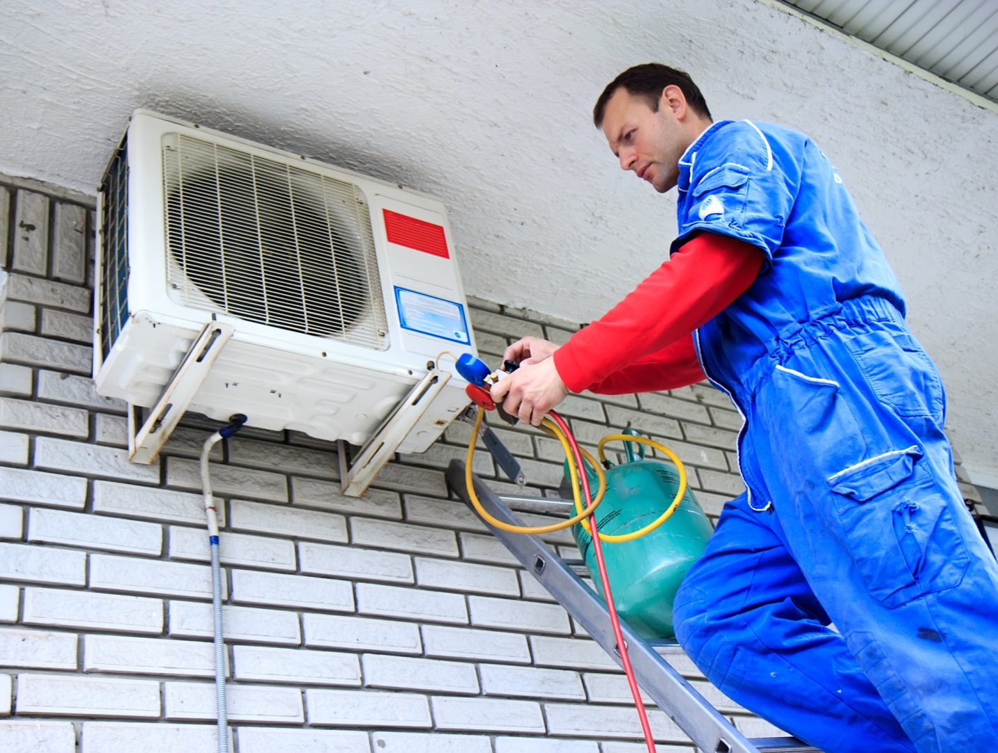 Man repairing an AC unit blower